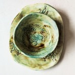 Glazed blue & brown hand made pottery bowl &/or plate with vintage lace texture